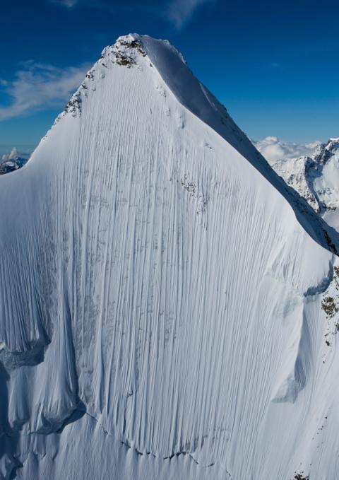 Can you spot the skier? Somewhere in this photo is an extreme sportsman plummeting down a near-vertical 13,000ft peak